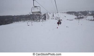 Chairlift in the mountains - chairlift at a ski resort