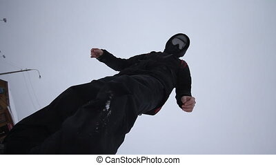 Snowboarder coming down on a snowbo - snowboarder coming...