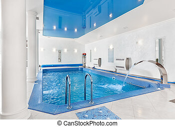 Indoor big blue swimming pool interior in modern minimalism...