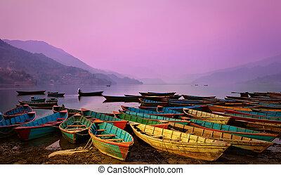 Beautiful twilight landscape with boats on Phewa lake,...