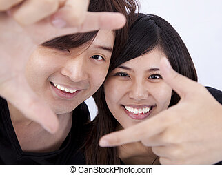 Closeup of a smiling young woman and man