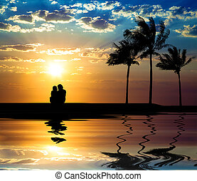 The silhouette of couple watching