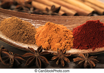 Seasoning - Cooking ingredients - warm colours of herbs and...