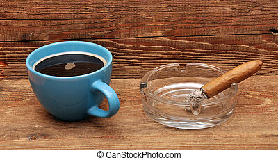 coffee and cigars on wood background