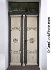 Double Door - Old double door with wood carving. Shot from...