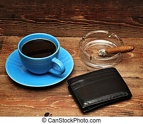 coffee, cigars and purse on wood background