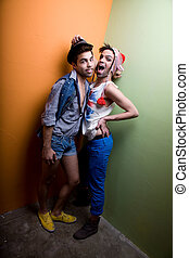 Attractive gay couple in funky clothing