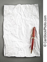 Wrinkled paper background with pen