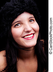 Beautiful young woman smiling with hat, isolated on black, studio shot