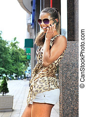 girl speaks by mobile phone - happy young girl speaks by a...