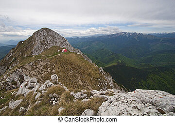 mountain top - red on the crest of a mountain refuge