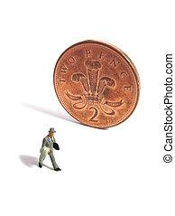 Minaiture man and british coin
