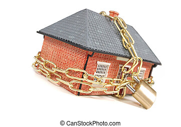 House in chains - House tied with a gold chain and padlock
