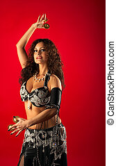 Beauty woman belly dance with finger cymbals - Beauty woman...