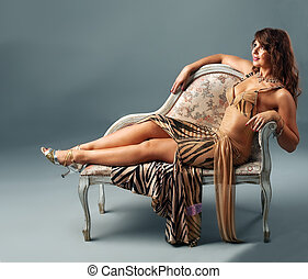 arabian dancer relax on old-styled chair - arabian dancer in...