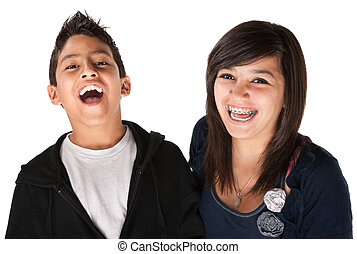 Two Smiling Siblings - Two hispanic kids laughing on white...