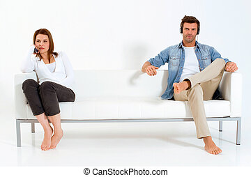 separated couple on the couch watching TV