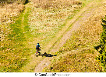 Mountain Biker Off-Road - Mountain biker on off-road trail...