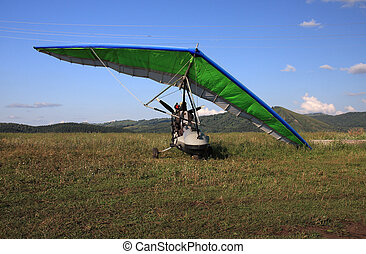 Hang-glider on a background mountains.