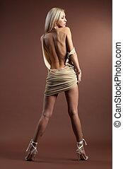 Beautiful girl - Beautiful sexual girl model pose on brown...