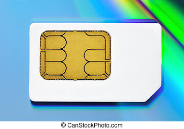SIM card - white SIM card on a multi-coloured background
