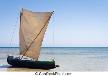 Malagasy outrigger pirogue with makeshift sails