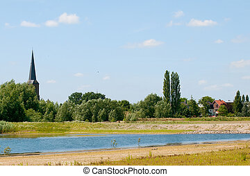 River the Lek in Holland - Landscape with small village near...