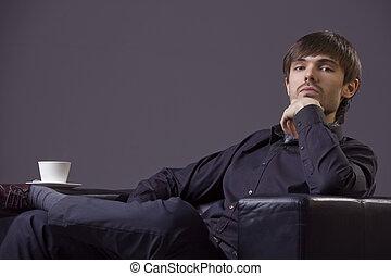 arrogant male - portrait of arrogant male sitting in chair...