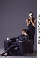couple conflict - woman holding white mask and arrogant man...