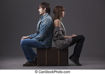sad couple with suitcase - conflict in relationship - man...