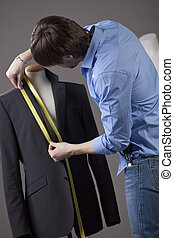 tailor - male tailor by the work on business jacket