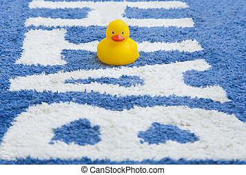Rubber Duckie on Bathmat - A yellow rubber duck on a bathmat...