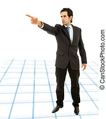 pointing - young business man in a suit pointing with his...