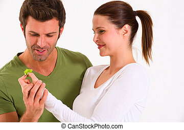Couple with a leaf of salad