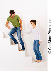 Couple up the stairs holding hands