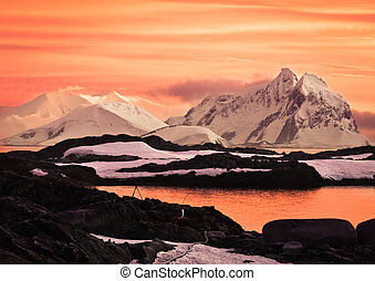 Beautiful snow-capped mountains at sunset in Antarctica