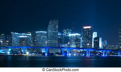 Time lapse of the Miami skyline at night - pan to the right