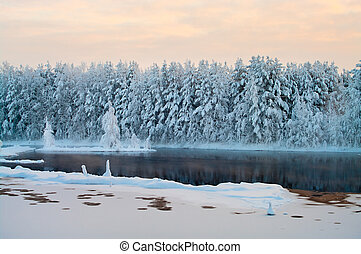 Unfrozen lake in the winter forests of Karelia, Russia....