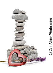 zen stones - a pile of zen stones with a wooden heart and...