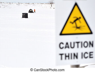 thin ice warning sign - A thin ice warning sign for frozen...