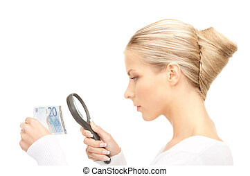 woman with magnifying glass and money - lovely woman with...