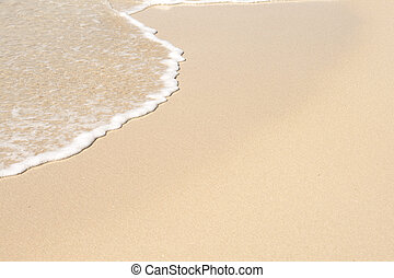 Wave whitewater on perfect white sand beach