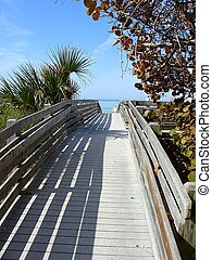 Wooden Walkway to the Beach - A wooden walkway leads over...