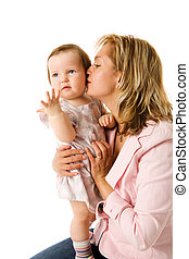 Mother kissing daughter on hands isolated on white