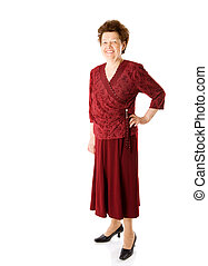 Happy old lady in red clothes standing isolated on white