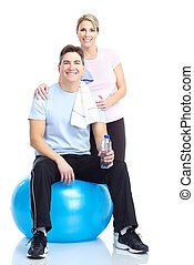 Gym and Fitness - Gym Fitness Smiling mature couple working...