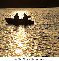 two in a boat - Single fisherman on a quiet