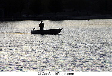 Boat on a lake - Single fisherman on a quiet