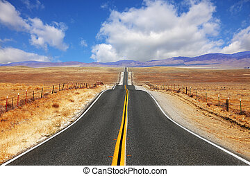 Excellent highway in California Steppe and clouds