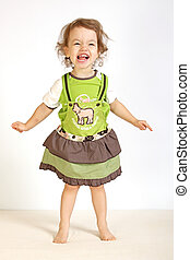 A little girl laughs. - A little girl expresses the...